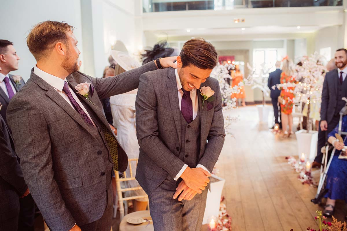 Groom waiting for his bride to walk down the aisle