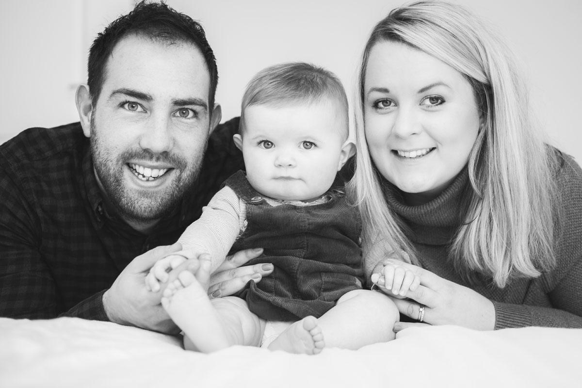 Mum, dad and child smiling